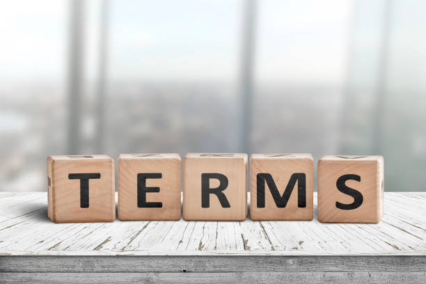 Terms sign in a bright office on a wooden desk stock photo