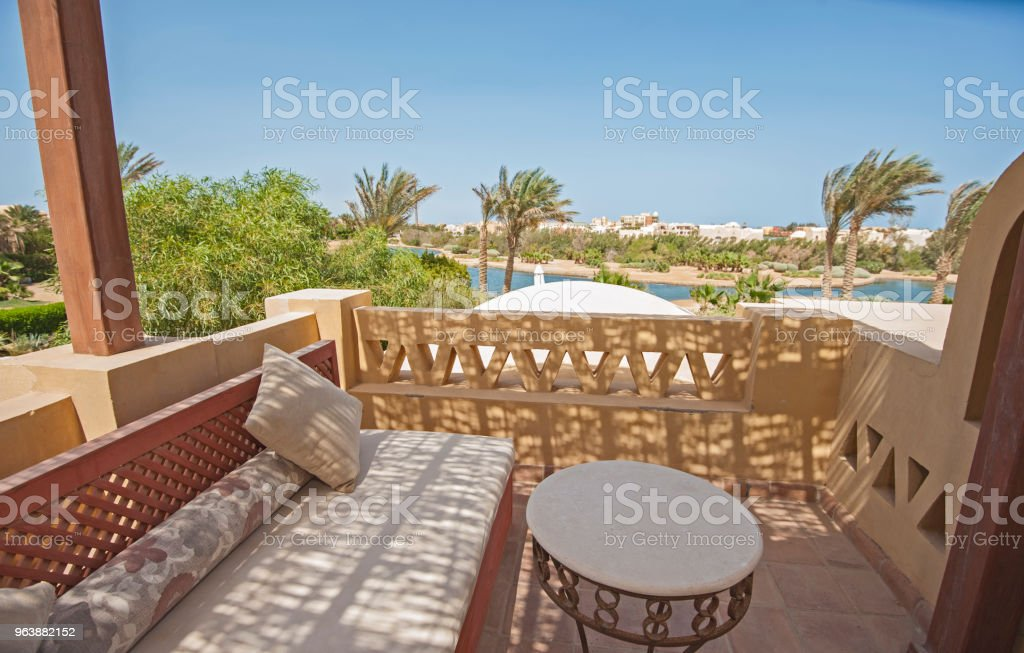 Terrace balcony with chairs in tropical luxury villa - Royalty-free Architectural Column Stock Photo