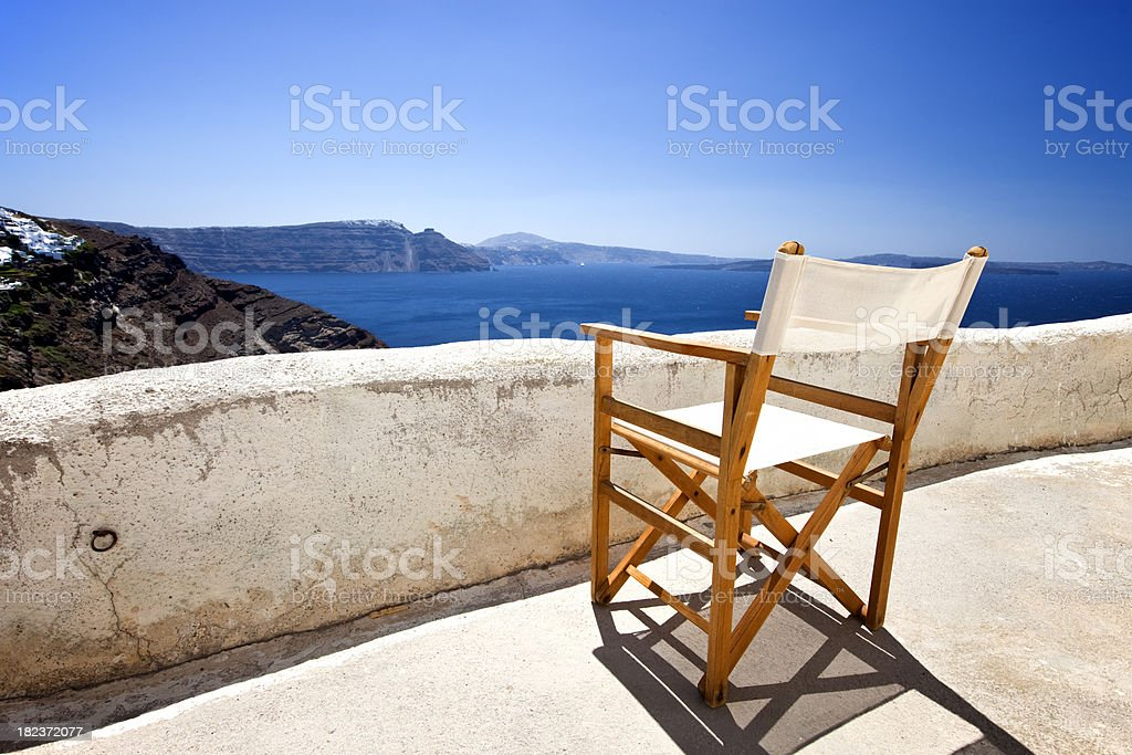 Terrace chair with view on Santorini caldera royalty-free stock photo