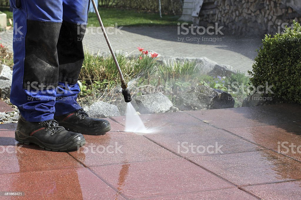 Terrace cleaning with high-pressure stock photo