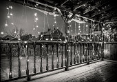 The terrace view, decorated with Christmas lights. Black and white photo.