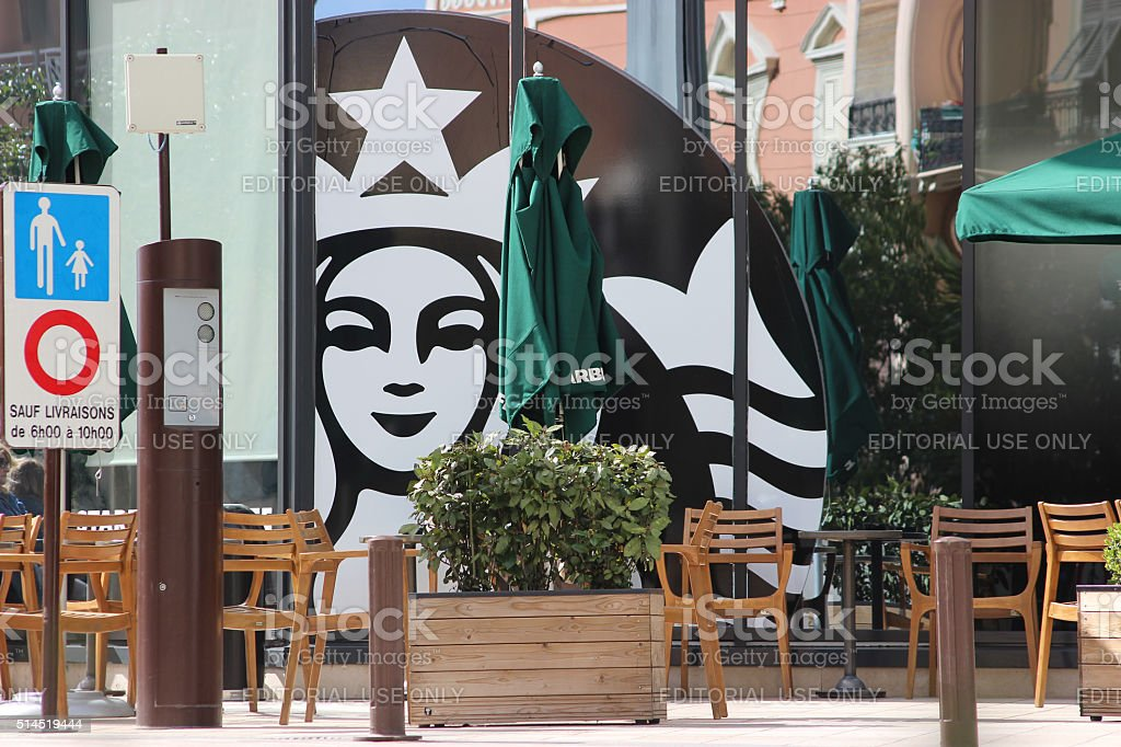 Terrace of a Restaurant and Starbucks Mermaid Sign stock photo
