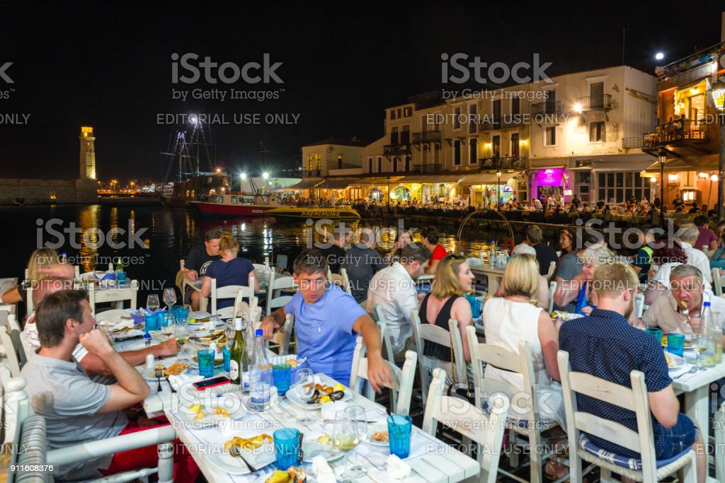 Terrace of restaurant full of people Rethymno city -Crete, Greece stock photo