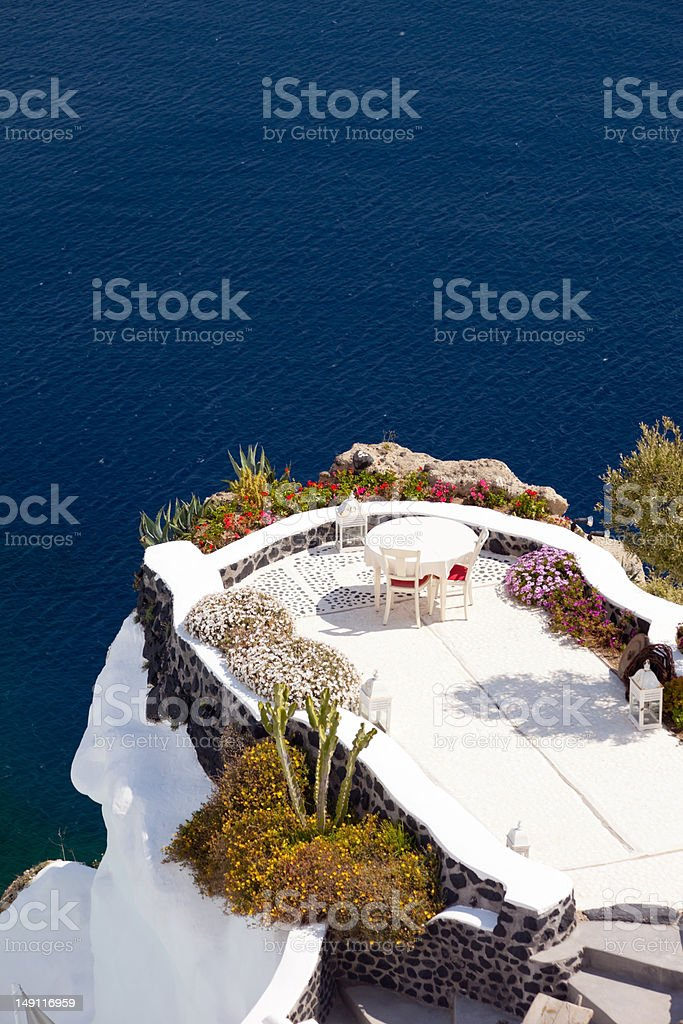 Terrace on the cliff in Oia Santorini Island royalty-free stock photo