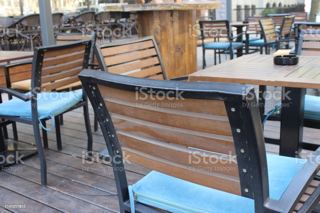 View on several terrace restaurant outdoor iron tables and chairs...