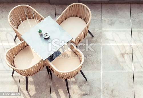 Empty chair and table directly above