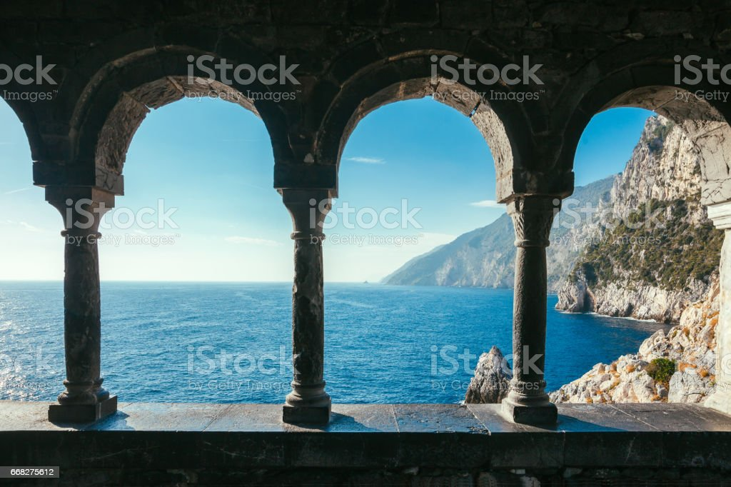 Terrace with arches overlooking scenic sea view and mountains in Italy stock photo