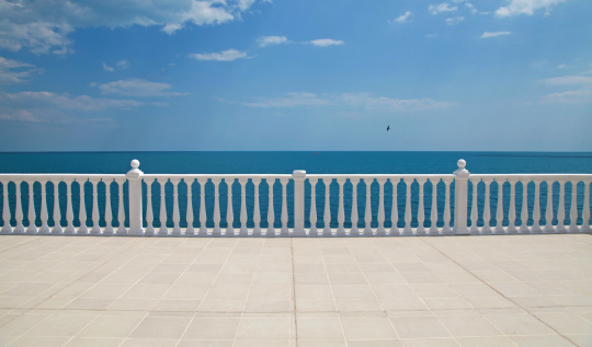 terrace with balustrade overlooking the sea
