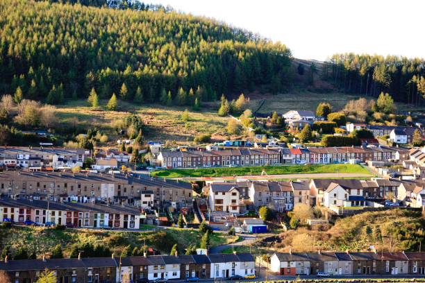 Terraced houses in Rhondda, Wales Terraced homes near Treorchy, Rhondda valley, Wales in the evening sun south wales stock pictures, royalty-free photos & images