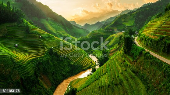 Terraced rice field landscape near Sapa in Vietnam. Mu Cang Chai Rice Terrace Fields stretching across the mountainside, layer by layer reaching up as endless, with about 2,200 hectares of rice terraces, of which 500 hectares of terraces of 3 communes such as La Pan Tan, Che Cu Nha and Ze Xu Phinh.