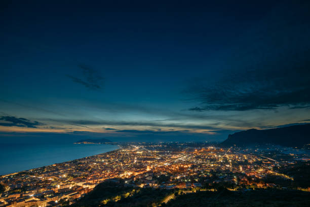 Terracina, Italy. Top View Skyline Cityscape City In Night Illuminations stock photo