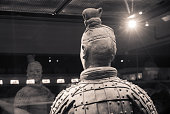 Xi'an, China - March 27, 2017 - Close-up of a terracotta archer showing hair and clothing details at the Mausolem of the First Qin Emperor.