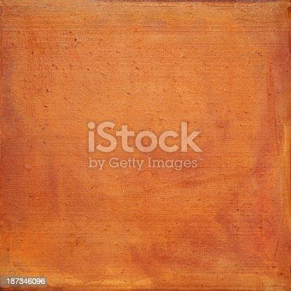 Terracotta background. Composite image.