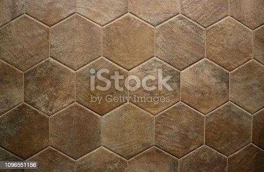 Terracotta rustic floor with hexagon shape tiles .