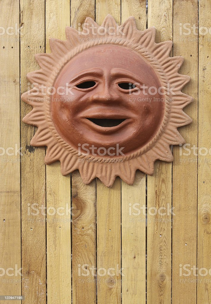 Terracotta Sun on Fence royalty-free stock photo