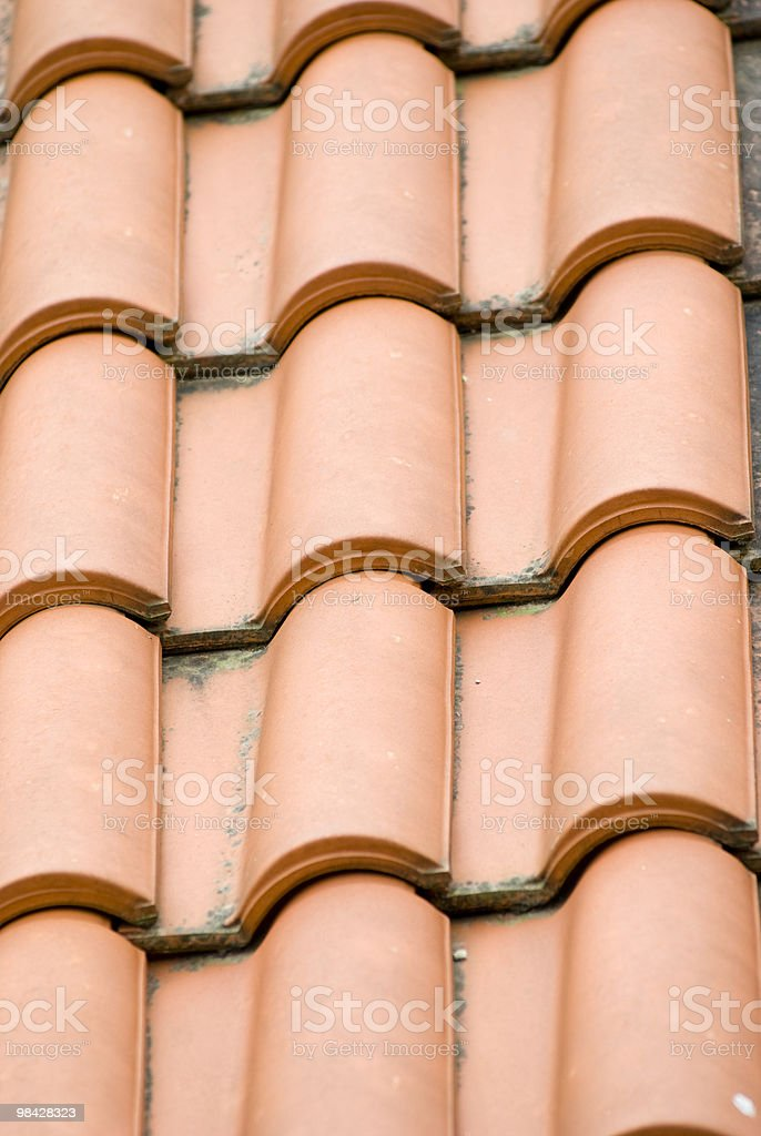 terracotta tiles on the roof of a house royalty-free stock photo