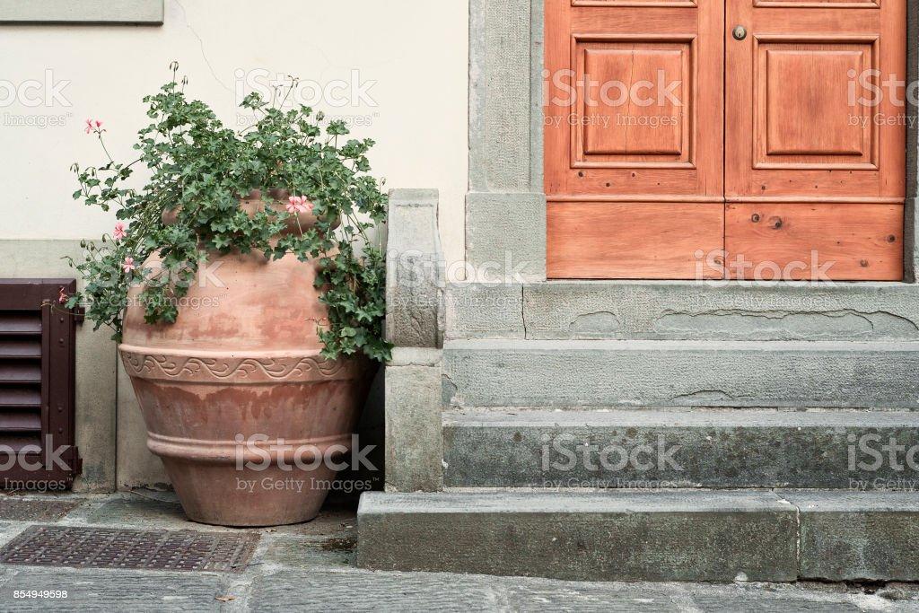 terracotta vase at the doorsteps stock photo