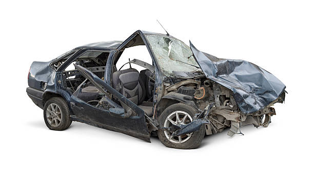 Terrible Crash Damaged car after a terrible crash. Isolated on white background. ruined stock pictures, royalty-free photos & images