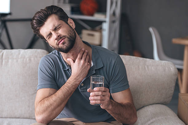 Terrible pain in his throat. stock photo