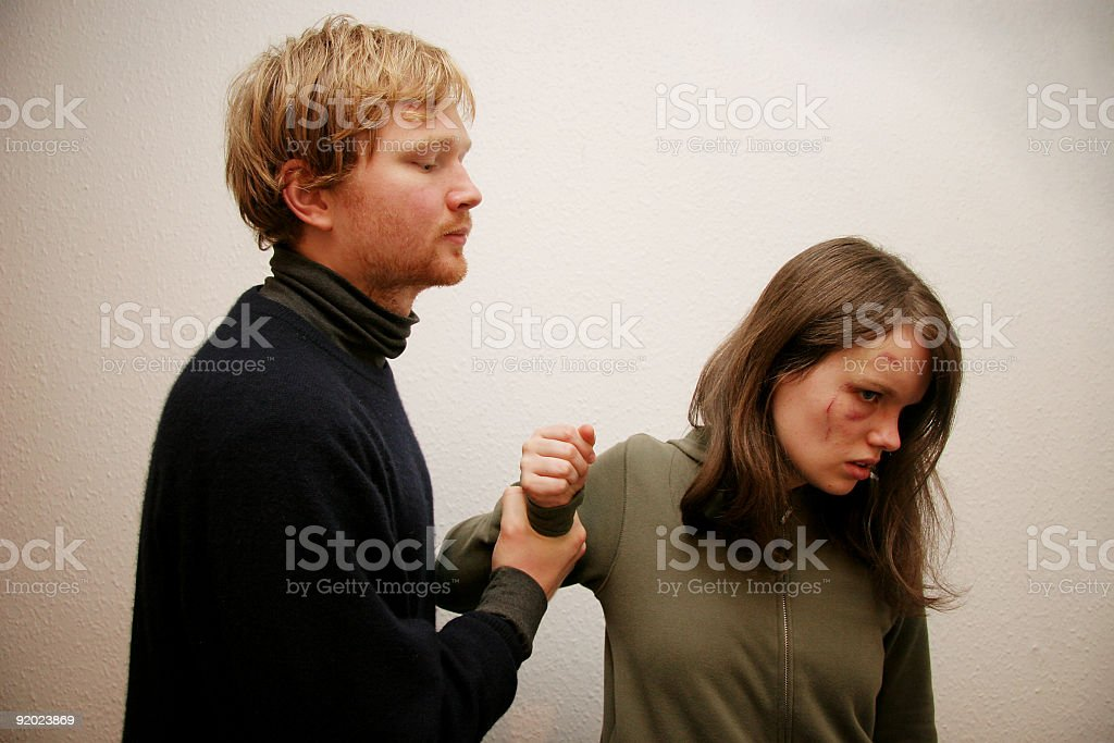 A terrible scene of an abusive relationship stock photo