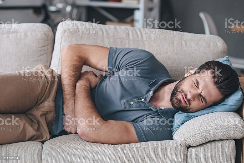 Terrible stomachache. stock photo