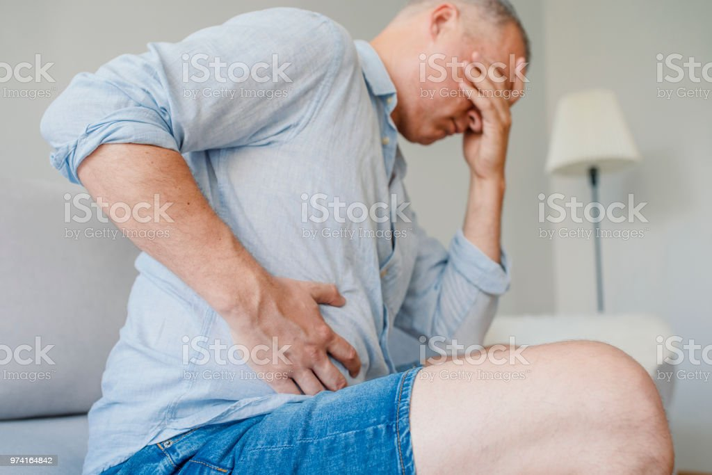 Terrible stomachache stock photo
