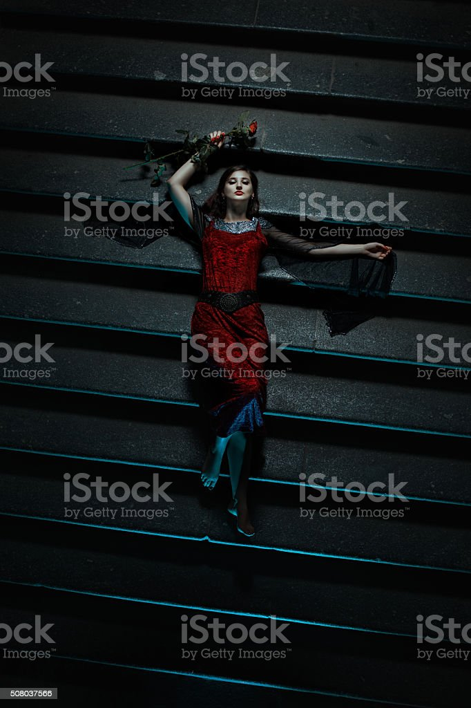 Terrible tale of a girl lying on the stairs. stock photo