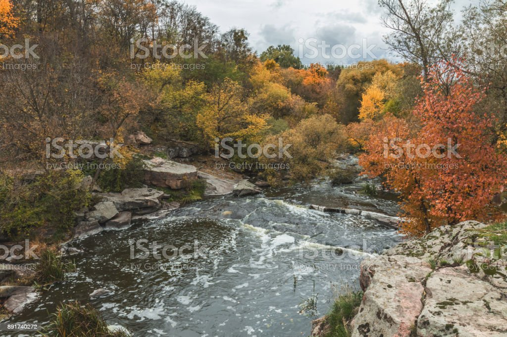 Terrific view of the River Canyon on a sunny fall dayTerrific view of the River Canyon on a cloudy fall day. Buky Canyon on the Hirs'kyi Tikych river in Ukraine royalty-free stock photo