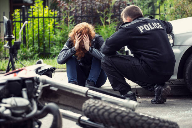 terrified victim of a traffic collision of motorcycle with a car and policeman - victim stock pictures, royalty-free photos & images