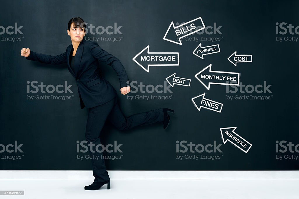 Terrified woman escaping from expenses stock photo