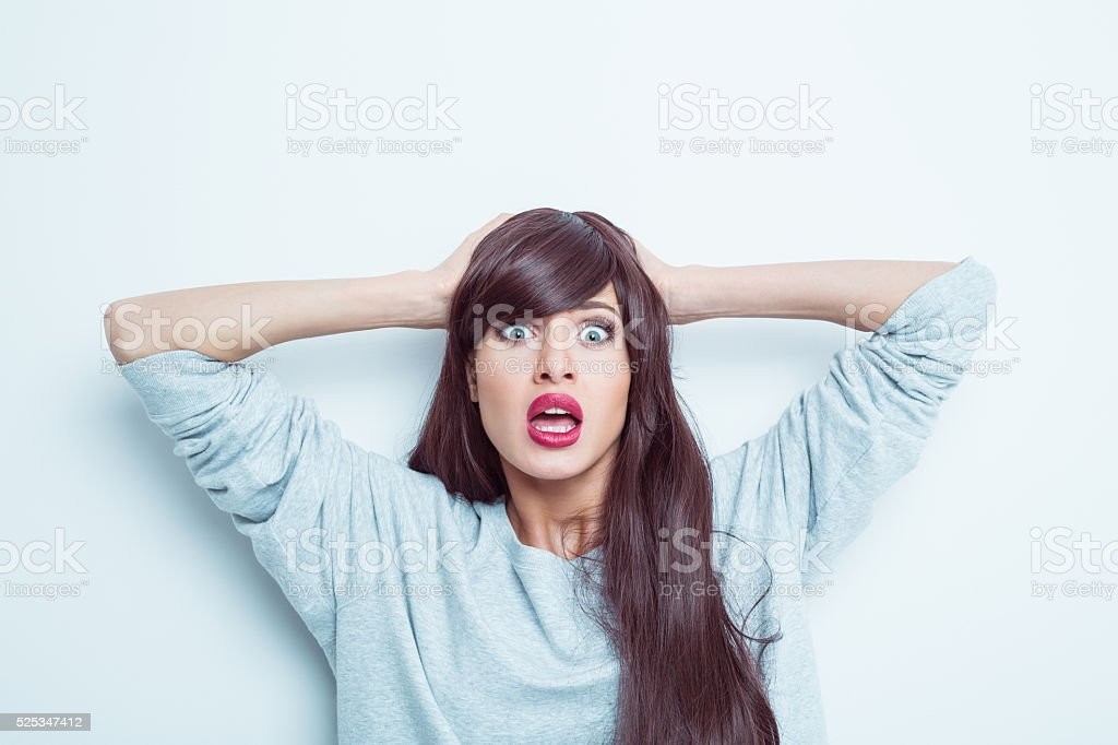 Terrified young woman stock photo