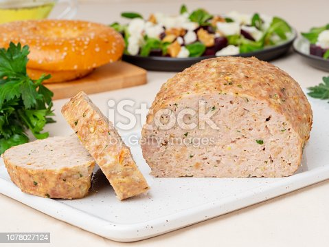 Terrine, meat loaf. Baked Turkey ground meat. Traditional French and American dish. Side view, white marble background