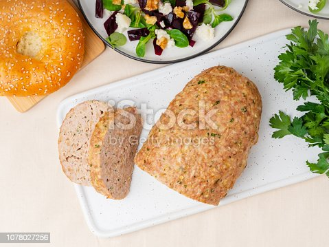 Terrine, meat loaf. Baked Turkey ground meat. Traditional French and American dish. Top view, white marble background