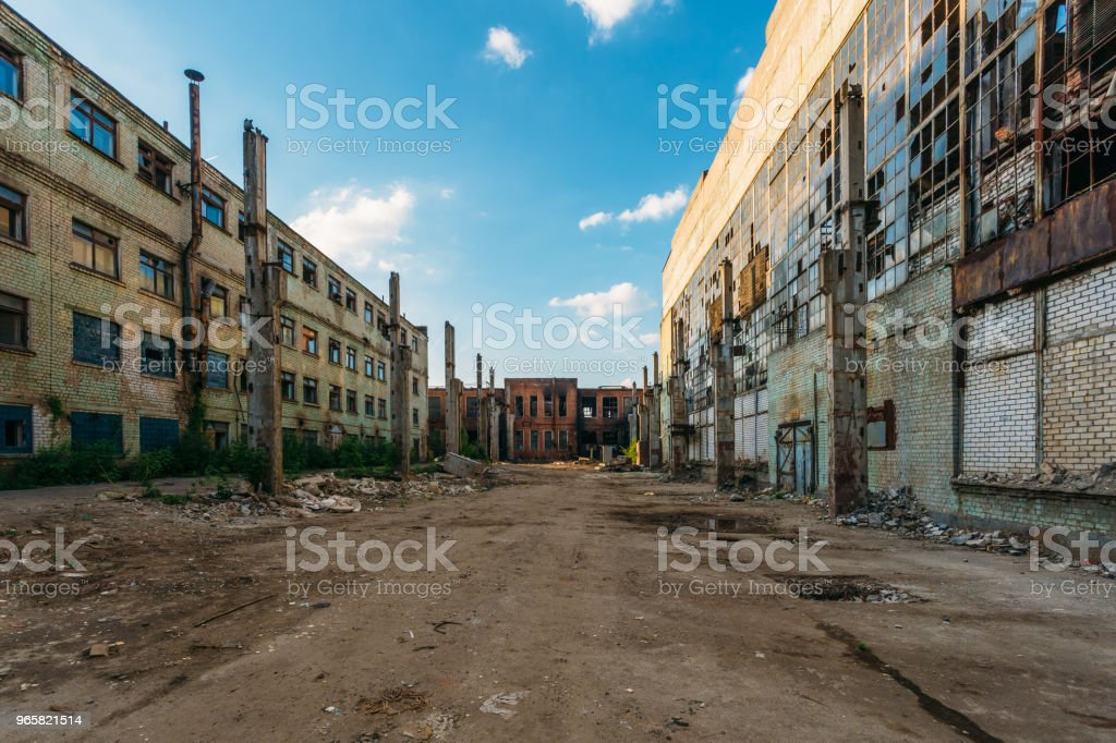 Territory of abandoned industrial area waiting for demolition. Broken and burnt buildings. Former Voronezh excavator factory stock photo