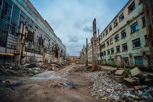 Territory of abandoned industrial area waiting for demolition. Junk at former Voronezh excavator factory