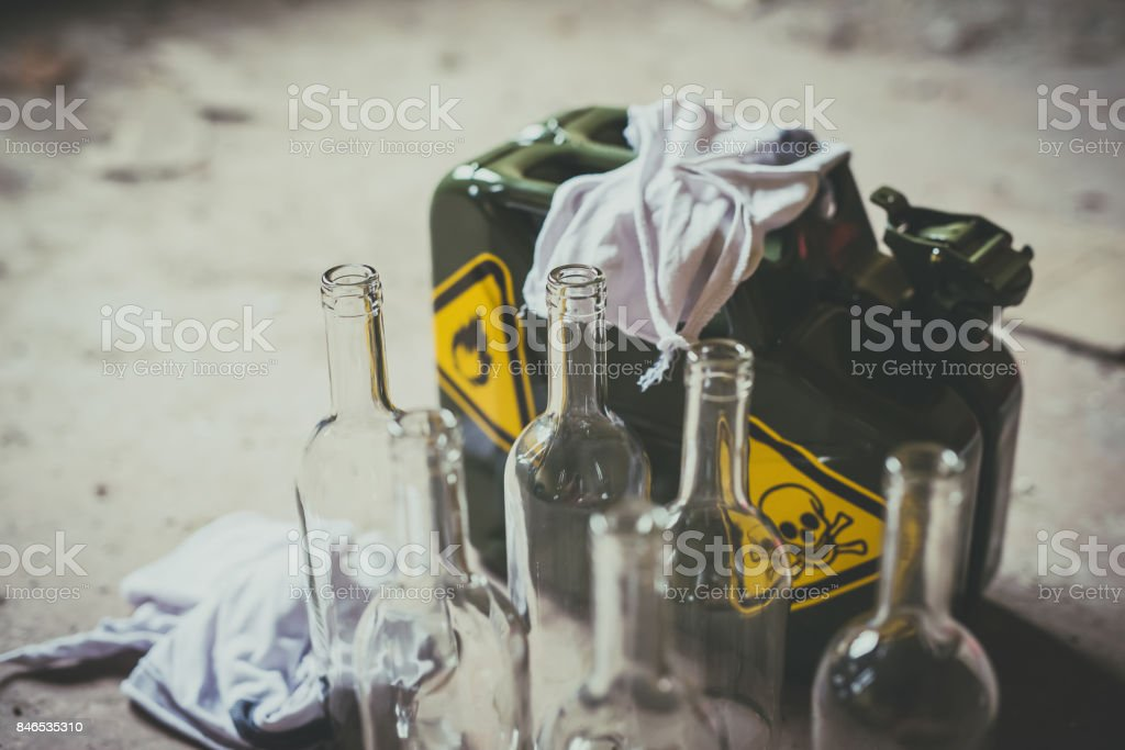 Terrorism. Molotov cocktail. Green military jerrycan with empty bottles stock photo