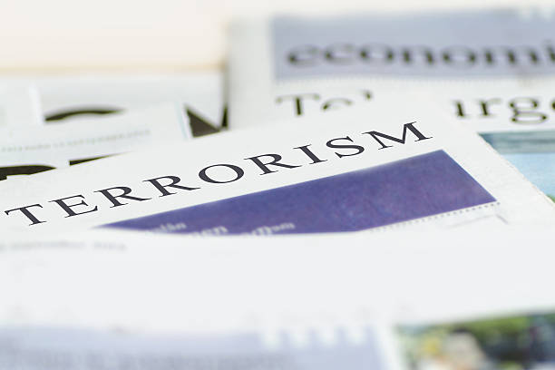 Terrorism Daily news newspaper headline reading terrorism concept. terrorism stock pictures, royalty-free photos & images