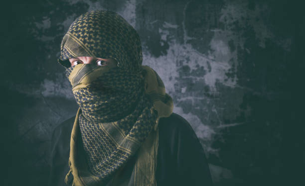 Terrorism Masked criminal portrait with grungy background concept terrorism stock pictures, royalty-free photos & images