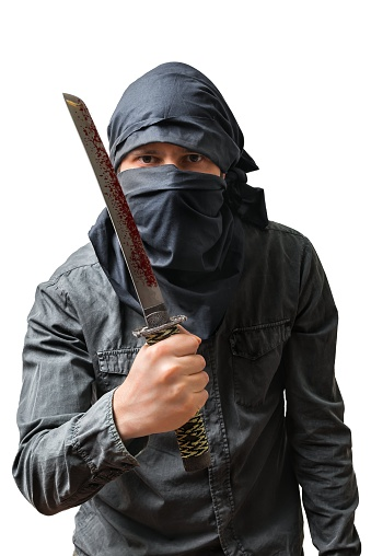 Terrorist holds bloody knife. Isolated on white. Terrorism concept.