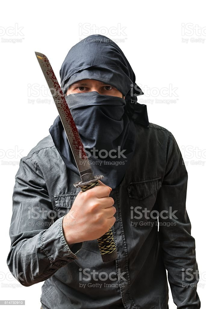 Terrorist holds bloody knife. Isolated on white. Terrorism concept. stock photo