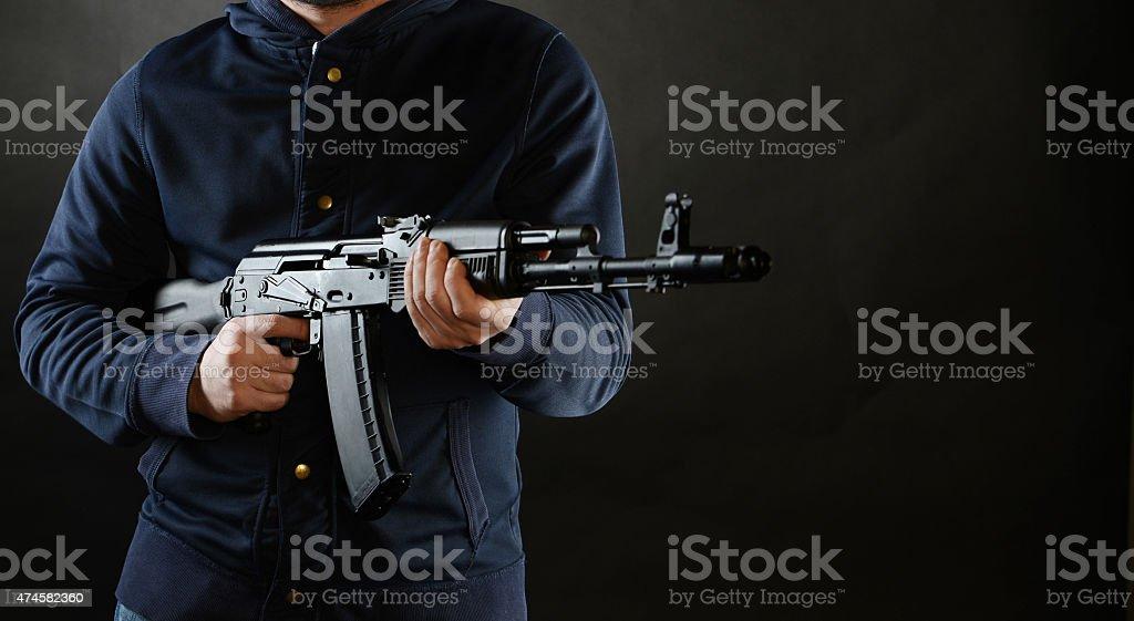 Terrorist is holding AKM 47 stock photo