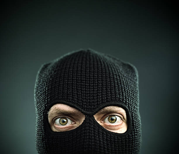 terrorist portrait - thief stock photos and pictures