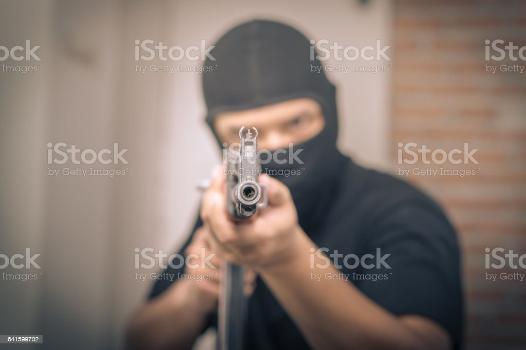 Terrorist sniper shooting with his weapon stock photo