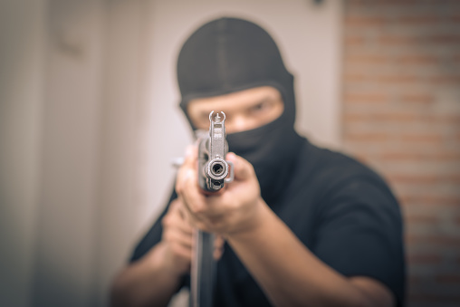 Terrorist Sniper Shooting With His Weapon Stock Photo - Download Image Now