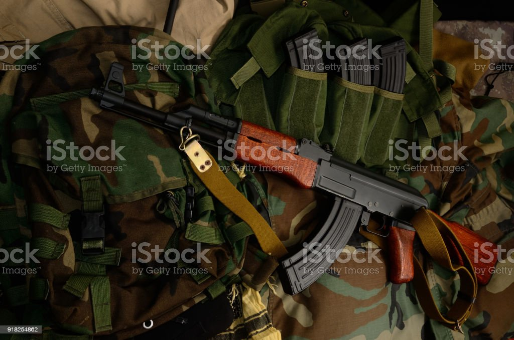 Terrorist Weapons with tactical chest rigs and backpack. stock photo