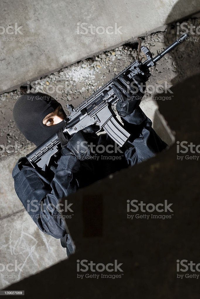 Terrorist with a rifle targeting royalty-free stock photo