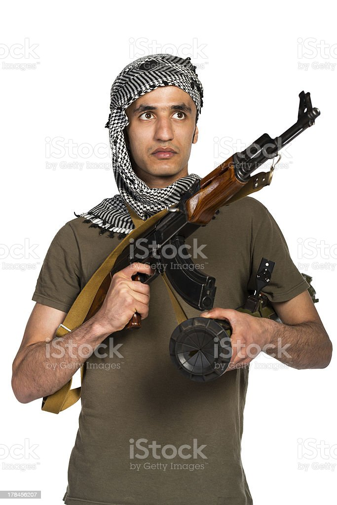 Terrorist with automatic gun and launcher on white background stock photo