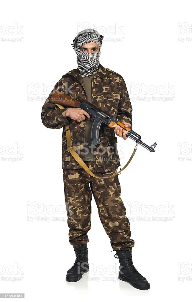 Terrorist with automatic gun on white background stock photo