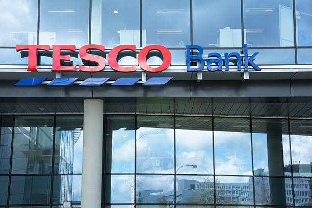 Tesco Bank Offices, Glasgow Glasgow, UK - April 17, 2012: Sign outside the Tesco Bank offices on Renfield Street in Glasgow city centre. Office workers are visible through the upper windows. theasis stock pictures, royalty-free photos & images