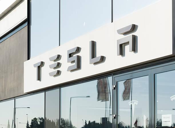 Tesla car dealer entrance Aarhus, Denmark - September 14, 2016: Tesla car dealer entrance tesla motors stock pictures, royalty-free photos & images